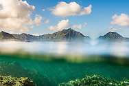 Split level view of a coral reef & the Koolau Mountains in the background, Kailua Bay, Oahu, Hawaii