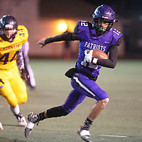 Lance Evans (12) carries the ball for Miyamura Patriots against Highland Hornets Friday night at Angelo DiPaolo Memorial Stadium in Gallup.