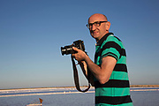 Tourist taking pictures at Gruissan, Languedoc-Roussillon, France.