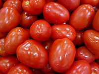 roma tomatoes for sale in a grocery store display