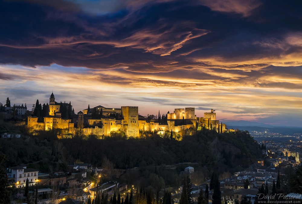 View of the Alhambra at dusk from Sacromonte hills.