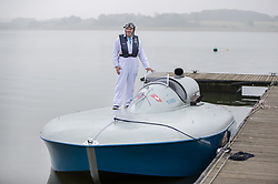 © Licensed to London News Pictures. 26/09/2017. Bewl Water, UK. Karl Foulkes Halbard stands on the deck of the fully restored Blue Bird K3 on Bewl Water ahead of a test run. Built in 1937 for Sir Malcolm Campbell, the K3 achieved three world water speed records in 1937-8 attaining a speed of 130.91mph. Blue Bird K3 has undergone an extensive restoration and is part of the Foulkes Halbard Collection at Filching Manor Motor Museum near Eastbourne. Photo credit: Peter Macdiarmid/LNP