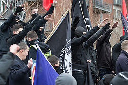 "© Licensed to London News Pictures . 21/03/2015 . Newcastle , UK . The crowd perform Nazi salutes . Neo-Nazis and skinheads from across Europe organise a "" White Man March "" in Newcastle , under the banner of "" National Action "" . Photo credit : Joel Goodman/LNP"