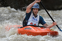 """Chad Sierman of Cape Girardeau, Mo. races in the K1 Men's Novice/Expert class on the slalom course of the 45th Annual Missouri Whitewater Championships. Sierman placed second in the class, first in the downriver K1 Men's Plastic (30-49) class and sixth in the K1 Men's Long Plastic 30 and up class. The Missouri Whitewater Championships, held on the St. Francis River at the Millstream Gardens Conservation Area, is the oldest regional whitewater slalom race in the United States. Heavy rain in the days prior to the competition sent water levels on the St. Francis River to some of the highest heights that the race has ever been run. Only expert classes were run on the flood level race course. Novices who chose to race were re-classified as """"novice experts"""" to recognize their achievements."""