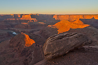 This scenic view is often mistaken for the Grand Canyon. It is actually Dead Horse Point State Park in Utah. It is the same Colorado River that carved this 2000 feet deep canyon that flows into Canyonlands National Park. As I stood on the edge of this cliff, I wondered how much of a push it would take to dislodge this boulder. It was perched right on the edge of a sheer 500+ foot drop.<br /> <br /> Date Taken: 11/6/2013