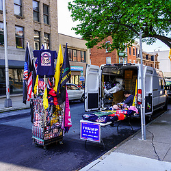 Harrisburg, PA / USA - May 15, 2020: A street vendor parked along a street in the downtown part of the city displays Trump 2020 campaign signs and merchandise for sale.
