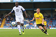 Bury's Pablo Mills (l) and Burton's Stuart Beavon battle for the ball. Skybet football league two match, Bury v Burton Albion at the JD Stadium, Gigg Lane in Bury, Lancs on Saturday 20th Sept 2014.<br /> pic by David Richards,  Andrew Orchard sports photography.