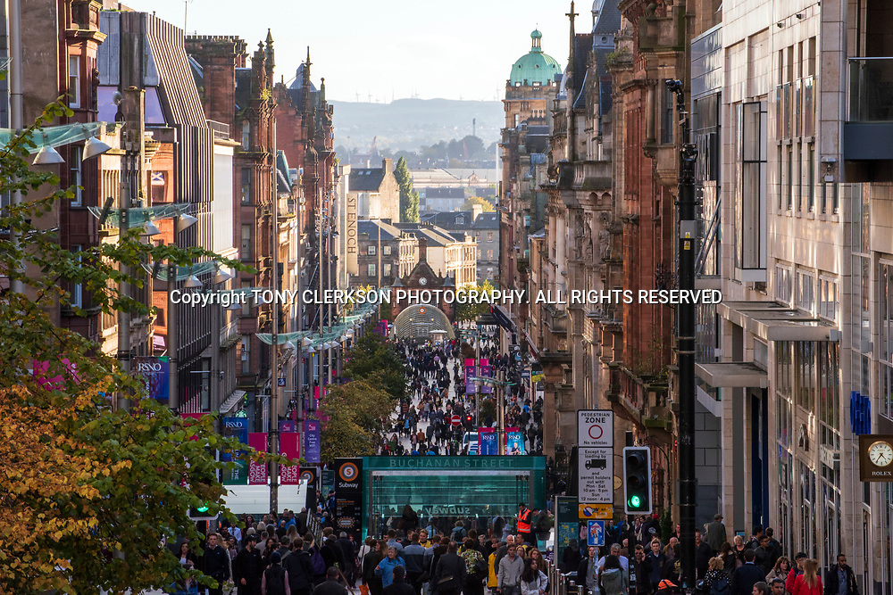 Tourists, workers and shoppers fill Buchanan Street, Glasgow main shopping thoroughfare as autumn colours add to the vibrancy