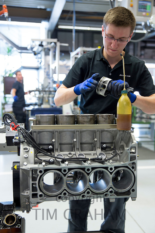 Mercedes-AMG engine production factory in Affalterbach, Germany - engineer checking and fitting pistons to 6.3 litre V8 engine