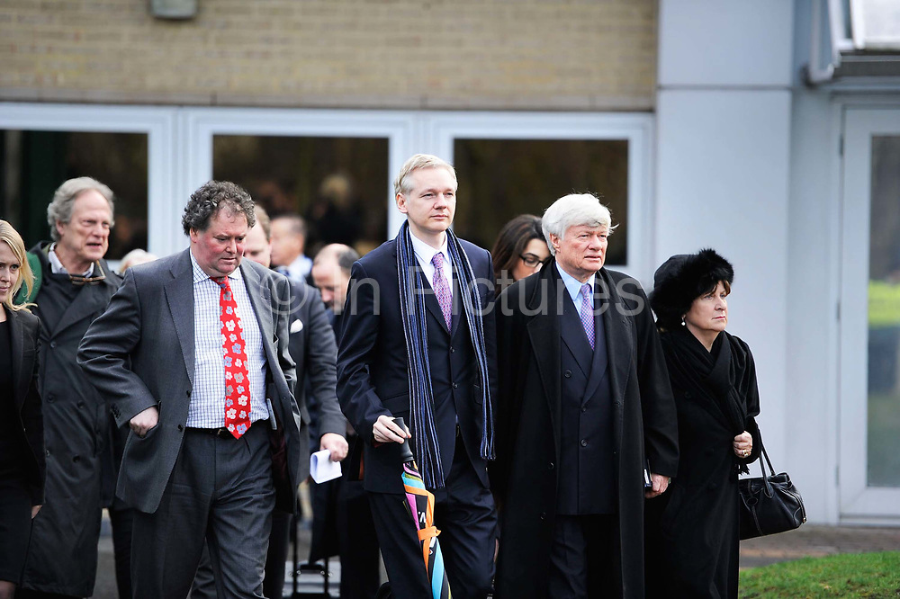 """WikiLeaks founder Julian Assange leaves with his lawyers Mark Stephens and Jennifer Robinson after his extradition hearing at Belmarsh Magistrates' Court in London February 11, 2011. A lawyer for Assange accused Sweden's prime minister on Friday of damaging his client's chances of a fair trial for alleged sex crimes by portraying him as """"public enemy number one""""."""