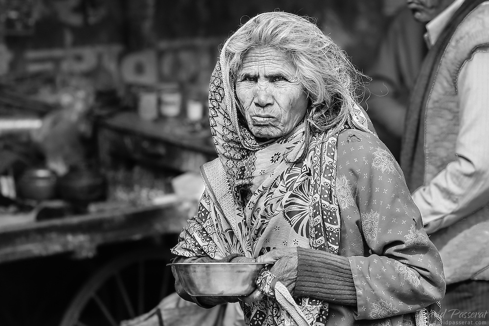 This begging old woman is hoping for generous people to give her enough money for food. I've always felt embarrassed taking pictures of this nature, but the expression of this old woman is powerful and somewhere beautiful.