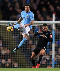 Manchester City's Kyle Walker (left) and West Ham United's Manuel Lanzini battle for the ball