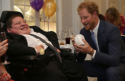 Prince Harry (right) reacts as he meets Inspirational Young Person Award Winner Myles Sketchley, as he attends the WellChild Awards in London. The awards recognise the courage of seriously ill children, their families and carers.