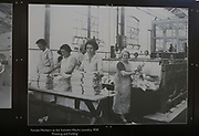 Public display of old historic images about the GWR works, Swindon, Wiltshire, England, UK female workers at works laundry 1930