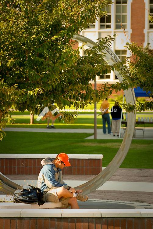 Student studying outside on campus at Boise State University, Boise, Idaho.
