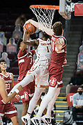 Stanford Cardinal forward Max Murrell (10) blocks and ties up Southern California Trojans forward Chevez Goodwin (1) during an NCAA men's basketball game, Wednesday, March 3, 2021, in Los Angeles. USC defeated Stanford 79-42. (Jon Endow/Image of Sport)