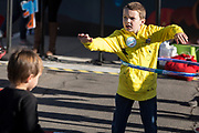 Colton Alford spins a hula hoop at the AARP Block Party at the Albuquerque International Balloon Fiesta in Albuquerque New Mexico USA on Oct. 8th, 2018.