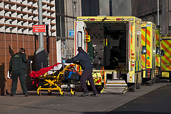 © Licensed to London News Pictures.25/01/2021, London,UK. A patient is transferred on stretcher from an ambulance at the Royal London Hospital in east London as the third national lockdown continues and hospitals are struggling to cope with the number of admissions. Photo credit: Marcin Nowak/LNP