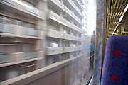 train passing a residential high rise at high speed