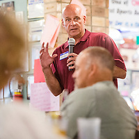042815       Cable Hoover<br /> <br /> New Mexico State University football coach Doug Martin speak to a crowd Thursday at Sammy C's in Gallup.