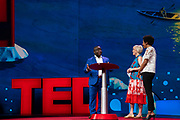 President Julius Maada Bio and Hosts Helen Walters and Whitney Pennington Rodgers speak at TED2019: Bigger Than Us. April 15 - 19, 2019, Vancouver, BC, Canada. Photo: Bret Hartman / TED