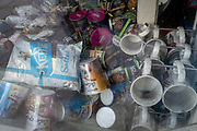 Smoke-damaged packets of crisps, breakfast pots and other snacks, plus London tourist mugs lie on the floor of a closed retailer that has experienced a small fire in Waterloo during the third lockdown of the Coronavirus pandemic, on 11th March 2021, in London, England.