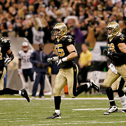 2009 November 30: New Orleans Saints cornerback Mike McKenzie (34) and linebacker Scott Fujita (55) and linebacker Scott Shanle (58) run off the field during a 38-17 win by the New Orleans Saints over the New England Patriots at the Louisiana Superdome in New Orleans, Louisiana.