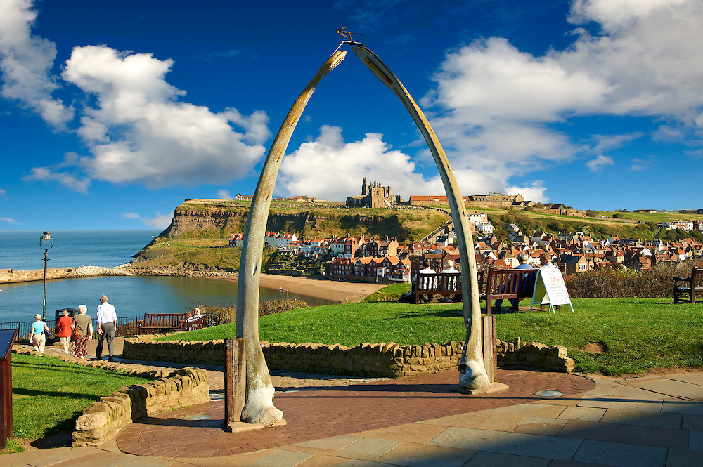 Whale Bone arch overlooking Whitby harbour with Whitby Abbey on the headland . Whitby, North Yorkshire, England .<br /> <br /> Visit our ENGLAND PHOTO COLLECTIONS for more photos to download or buy as wall art prints https://funkystock.photoshelter.com/gallery-collection/Pictures-Images-of-England-Photos-of-English-Historic-Landmark-Sites/C0000SnAAiGINuEQ