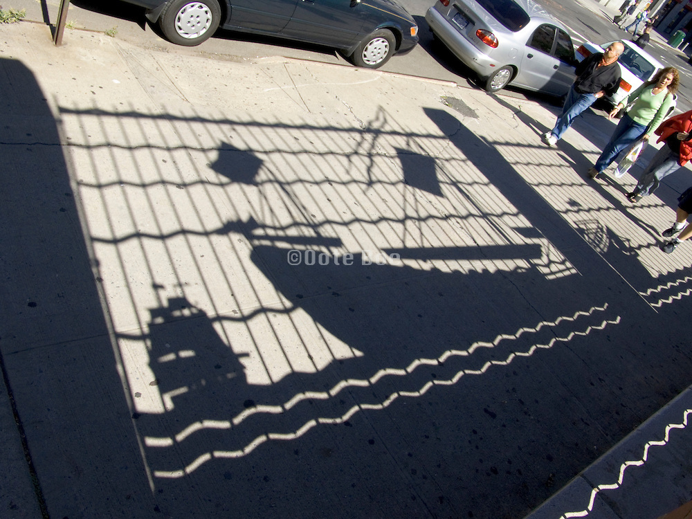 shadow of old wooden ships on pedestrian pavement