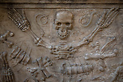 Interior stone carvings of a skeleton in Narbonne Cathedral in Narbonne, France. Cathedrale Saint-Just-et-Saint-Pasteur de Narbonne, is a Gothic style Roman Catholic church located in the town of Narbonne, France. The cathedral is a national monument and dedicated to Saints Justus and Pastor.