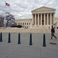 Tourists walk in front of the U.S. Supreme Court building in Washington, DC.