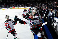 KELOWNA, BC - MARCH 7: Matthew Wedman #20, Kaedan Korczak #6 and Kyle Topping #24 of the Kelowna Rockets celebrate a goal with fist bumps along the bench against the Lethbridge Hurricanes at Prospera Place on March 7, 2020 in Kelowna, Canada. (Photo by Marissa Baecker/Shoot the Breeze)