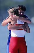 Barcelona Olympics 1992 - Lake Banyoles, SPAIN, ROM, W1X Medals Gold, LIPA, Elisabeta, hugs, CAN W1X Bronze, LAUMANN, Silken Suzette.  Photo: Peter Spurrier.       {Mandatory Credit: © Peter Spurrier/Intersport Images]..........       {Mandatory Credit: © Peter Spurrier/Intersport Images].........
