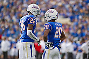 Dec 1, 2012; Tulsa, Ok, USA; Tulsa Hurricanes defensive backs Dexter McCoil (26) and Demarco Nelson (20) talks on the field during a game against the University of Central Florida Knights at Skelly Field at H.A. Chapman Stadium. Tulsa defeated UCF 33-27 in overtime to win the CUSA Championship. Mandatory Credit: Beth Hall-USA TODAY Sports