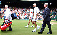 Roger Federer and Mark Philippoussis walk out for the Mens Singles Final with Referee Alan Mills and the man who carries their bags. Wimbledon Tennis Championship, Day 13, 6/07/2003. Credit: Colorsport / Matthew Impey DIGITAL FILE ONLY