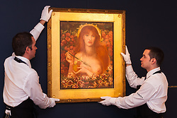 Sotheby's, London, December 5th 2014. World renowned aution house Sotheby's is to offer a collection of British and Continental masters to be sold at auction on December 10th 2014. PICTURED: Sotheby's gallery technicians hang Rossetti's Verticordia, considered to be the artist's most sensuous picture, painted in 1868. This superb pre-Raphaelite artwork is expected to fetch up to £1.5 million at auction.