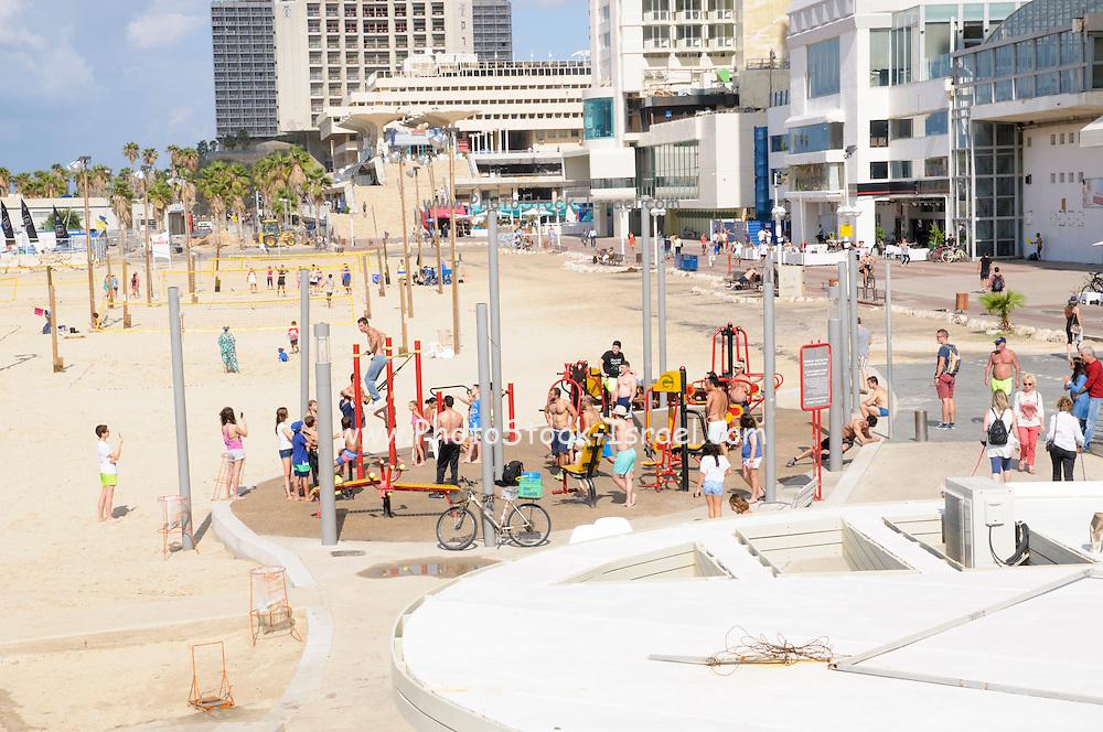 People use the public fitness equipment on Gordon Beach, Tel Aviv, Israel