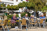 Plaza de Rosales, Estepona, Spain, tourists, snack, open air, cafe, al fresco, coffee, relaxation, 201902018377<br /><br />Copyright Image from Victor Patterson, Belfast, UK, BT9 5HG<br /><br />t: +44 28 9066 1296 <br />(from Rep of Ireland 048 9066 1296) <br />m: +44 7802 353836 <br />victorpattersonbelfast@gmail.com <br />www.victorpatterson.com<br /><br />Please see my Terms and Conditions of Use at https://www.victorpatterson.com/page2 <br /><br />It is IMPORTANT that you familiarise yourself with them.<br /><br />Images used on the Internet incur an additional cost and must be visibly watermarked i.e. © Victor Patterson within the body of the image and copyright metadata must not be deleted. Images used on the Internet have a size restriction of 4kbs and are chargeable at rates available at victorpatterson.com.<br /><br />This image is only available for the use of the download recipient i.e. television station, newspaper, magazine, book publisher, etc, and must not be passed on to any third party. It is also downloaded on condition that each and every usage is notified within 7 days to victorpattersonbelfast@gmail.com<br /><br />The right of Victor Patterson to be identified as the author is asserted in accordance with The Copyright Designs And Patents Act (1988). All moral rights are asserted.