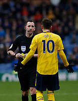 Football - 2019 / 2020 Premier League - Burnley vs. Arsenal<br /> <br /> Referee Chris Kavanagh shows Mesut Ozil of Arsenal the yellow card, at Turf Moor.<br /> <br /> <br /> COLORSPORT/ALAN MARTIN