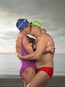 Elderly couple kissing on the beach<br /> Photography by Zac Macaulay<br /> Tel 0044 07947 884 517<br /> www.linkphotographers.com