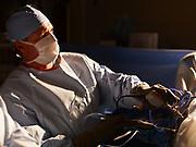 Surgeon performing athroscopic orthopedic surgery.
