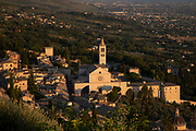 View over the Cathedral of San Rufino and the town at sunset and the valley south of Assisi, Umbria, Italy. In this church Saint Francis of Assisi, Saint Clare, and many of their original disciples were baptised. Assisi is a town in the Province of Perugia in the Umbria region, on the western flank of Monte Subasio. It is generally regarded as the birthplace of the Latin poet Propertius, and is the birthplace of St. Francis, who founded the Franciscan religious order in the town in 1208, and St. Clare, Chiara dOffreducci, the founder of the Poor Sisters, which later became the Order of Poor Clares after her death. Assisi is now a major tourist destination for those sightseeing or for more religious reasons.