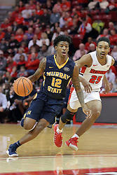 "09 December 2017:  Temetrius ""Ja"" Morant leads defender Madison Williams past the arc during a College mens basketball game between the Murray State Racers and Illinois State Redbirds in  Redbird Arena, Normal IL"