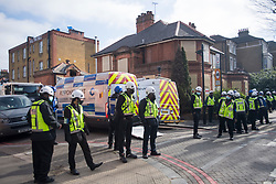 © Licensed to London News Pictures. 29/03/2021. London, UK. Police and bailiffs surround the former Cavendish Road Police Station in Clapham in south London where squatters previously occupied the building as part of a 'Kill The Bill' protest. Murdered woman Sarah Everard walked past the building on the night she went missing on March 3, 2021. Photo credit: Ben Cawthra/LNP