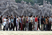"""Scores of visitors line up to catch a glimpse of Mao Zedong's embalmed body in Tiananmen Square in Beijing September 7, 2006. Mao died 30 years ago on September 9th. A flawed, dangerous man, Mao harnessed the power of hundreds of millions of Chinese through the Communist Party in the 1950s, declaring """"We must help all the young people to understand that ours is still a very poor country, that we cannot change this situation radically in a short time, and that only through the united efforts of our younger generation and all of the people, working with their own hands, can China be made strong and prosperous within a period of several decades."""""""