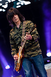 "© Licensed to London News Pictures. 07/06/2013. London, UK.  John Squire of The Stone Roses performing live at Finsbury Park. The Stone Roses are an English rock band formed in Manchester in 1983, consisting of vocalist Ian Brown, guitarist John Squire, bassist Gary ""Mani"" Mounfield, and drummer Alan ""Reni"" Wren. They were one of the pioneering groups of the Madchester movement that was active during the late 1980s and early 1990s.   Photo credit : Richard Isaac/LNP"
