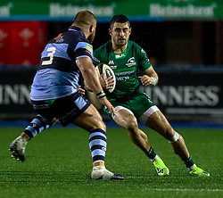 Tiernan O'Halloran of Connacht under pressure from Dimitri Arhip of Cardiff Blues<br /> <br /> Photographer Simon King/Replay Images<br /> <br /> Guinness PRO14 Round 14 - Cardiff Blues v Connacht - Saturday 26th January 2019 - Cardiff Arms Park - Cardiff<br /> <br /> World Copyright © Replay Images . All rights reserved. info@replayimages.co.uk - http://replayimages.co.uk