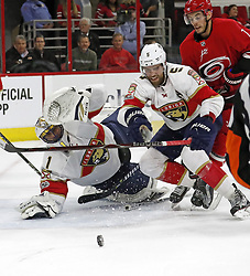 November 7, 2017 - Raleigh, NC, USA - The Flordia Panthers' Roberto Luongo (1) and Aaron Ekblad (5) defend the net against the Carolina Hurricanes' Derek Ryan (7) during the first period at PNC Arena in Raleigh, N.C., on Tuesday, Nov. 7, 2017. (Credit Image: © Chris Seward/TNS via ZUMA Wire)