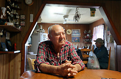 04 March 2016. Isle de Jean Charles, Louisiana.<br /> Vanishing land. First climate refugees in the USA. Isle de Jean Charles Band of Biloxi-Chitimacha Indians.<br /> Wenceslaus Billiot, father of deputy chief Boyo Billiot. The proud WW2 veteran and tribal elder may be forced to leave the home he has known all his life. The tribe has recently been awarded $52 million to resettle on higher ground as more and more of their land is consumed from erosion by the Gulf of Mexico.<br /> Photo©; Charlie Varley/varleypix.com