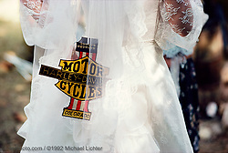Wedding Dress, Sturgis, SD. 1982<br /> <br /> Limited Edition Print from an edition of 50. Photo ©1982 Michael Lichter.<br /> <br /> The Story:Riding in the wind and elements, so close to the edge, bikers feel life. They are passionate about their bikes, their riding, their partying, their love.